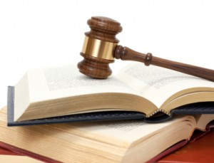 New York long-term disability attorneys Gavel on top of books