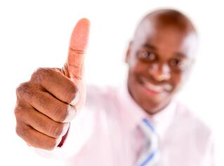 Business man with thumbs up - isolated over white background.jpeg