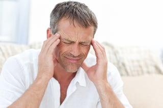Man having a headache at home.jpeg