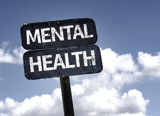 Mental Health sign with clouds and sky background.jpeg
